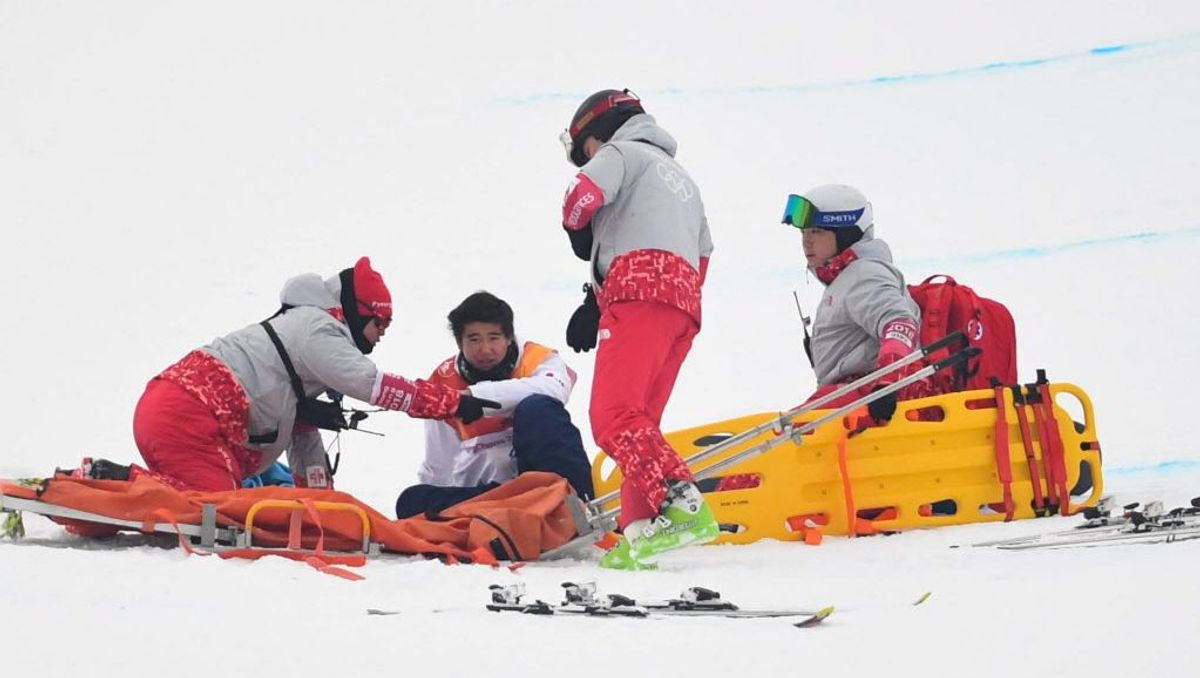 Olympic doctors tend to an injured athlete