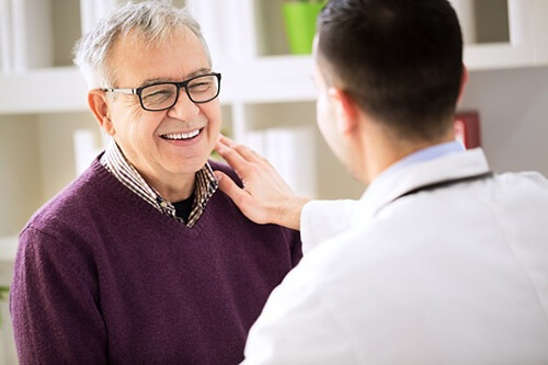Adult man meets with healthcare provider
