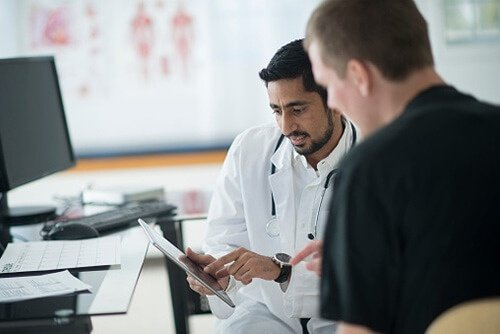 Doctor using technology to increase patient satisfaction