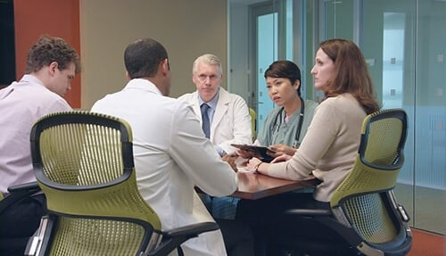 Healthcare staff reviews compassion initiatives to increase patient satisfaction