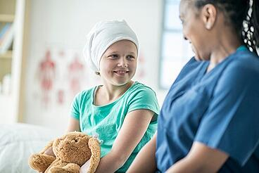 Nurse laughing with young patient