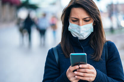 Woman texting her doctor